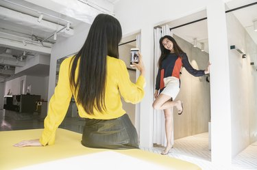 Chinese woman posing for photo by changing room