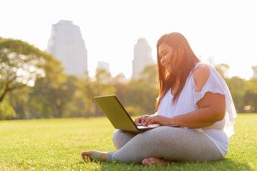 Beautiful Overweight Asian Woman Using Laptop Computer In Lumpini Park