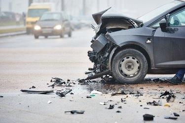 Car crash in urban street with black car