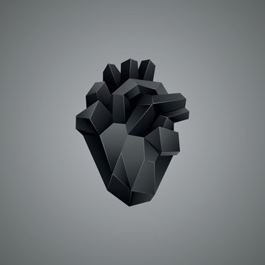 Black low poly human heart on a gray background.
