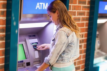 Do Credit Cards Have PIN Numbers?        Pretty brunette student withdrawing cash