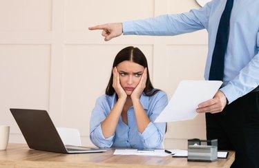 Boss Firing Woman Worker Sitting In Modern Office, Cropped