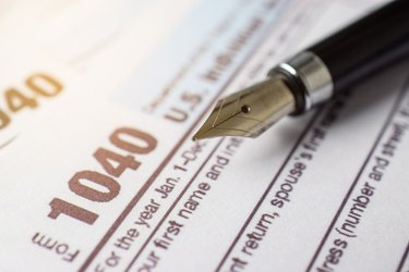 Tax form business financial concept with pen