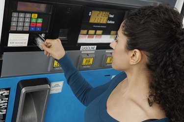 How to Use a Credit Card for GasWoman paying with credit card at gas pump