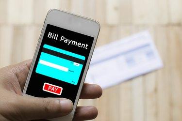 How to Pay a Bill Through a Savings Account