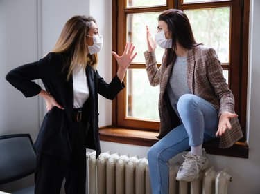 Two Young Entrepreneur Woman With Protective Face Mask Arguing In The Office