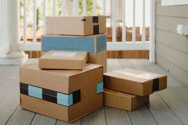 Stack of packages on front porch after mail delivery