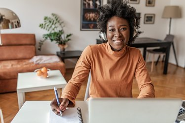 Young African American woman working from home