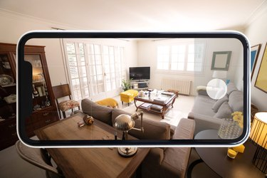 Visiting home interior using mobile phone with virtual reality technology.