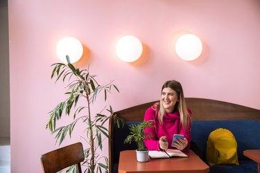 Happy Millennial in Colorful Cafe in Belgrade, Serbia
