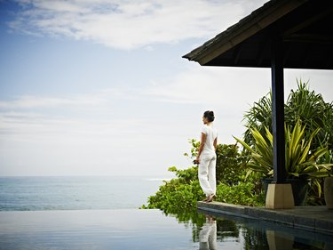 Woman standing at edge of infinity pool