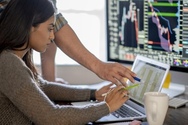 Young business woman day trading