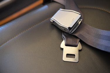 Seat belt lies on the aircraft seat Flight safety concept