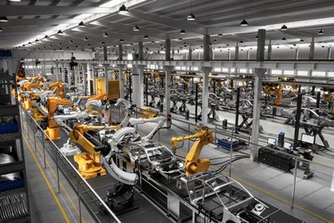 Cars on production line in factory