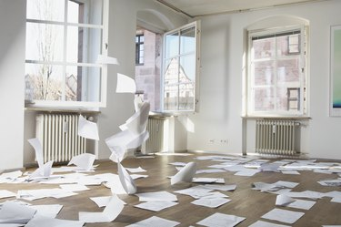 Papers blowing in wind indoors