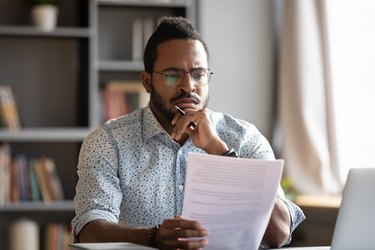 African male lawyer read contract details feels discontented concept