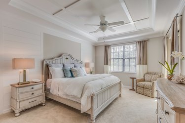 Beautifully decorated master bedroom with white and light brown tones