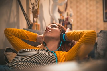 Women at home listening music