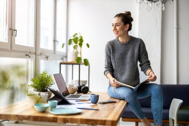 Young woman working in creative start-up company