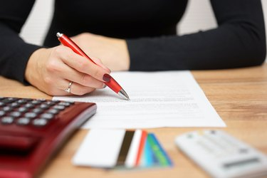 Woman reading notice about credit