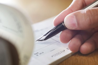 Hand writing cheque