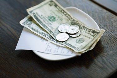 Dollar Bills and Receipt