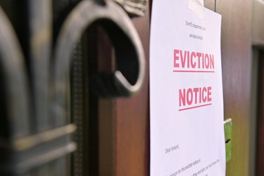 the notice of eviction of tenants hangs on the door of the house