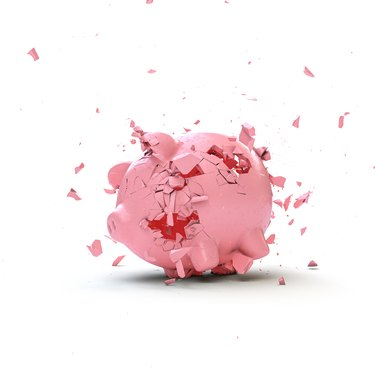 piggy bank shattering to the ground.