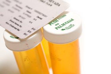 Insurance card and prescription pill bottles.