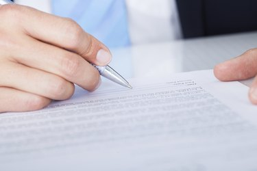 Businessman Signing Contract Paper