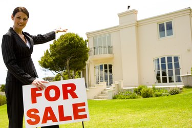 Real estate agent with house for sale