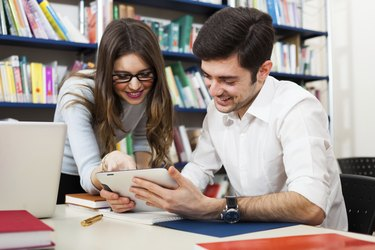Students using a digital tablet
