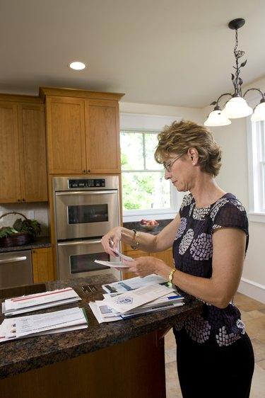 Woman looking through bills