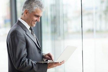 senior businessman working on laptop