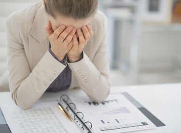 frustrated business woman working with documents in office