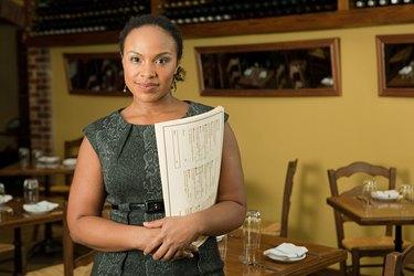 Portrait of female restaurant owner