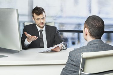 Manager discussing a problem with employee