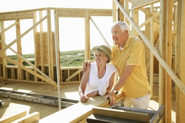 Couple at new home construction site
