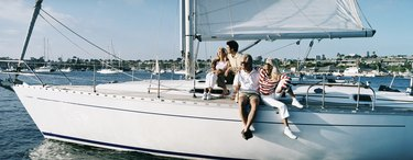 Family Couples Sitting on the Deck of a Sailing Yacht