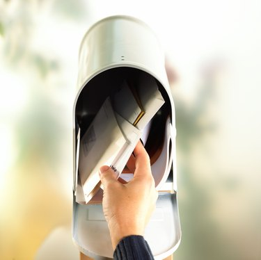 Hand with open mailbox