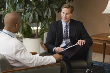Businessman talking to doctor indoors