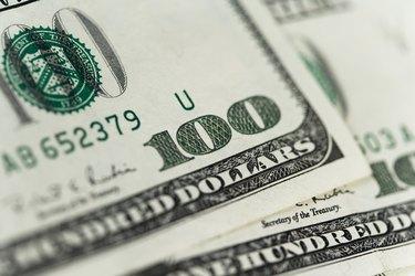 Close-up of one hundred dollar bills