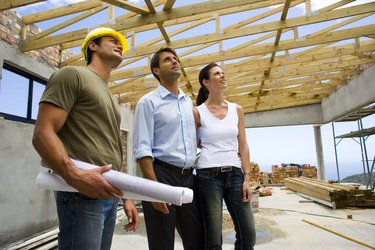 Couple with contractor in structure