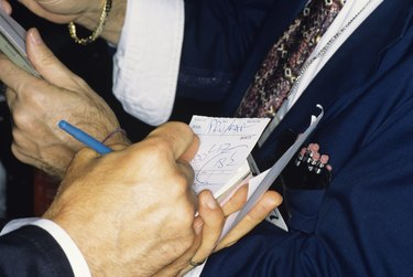 New York Stock Exchange transactions, close-up of traders hands