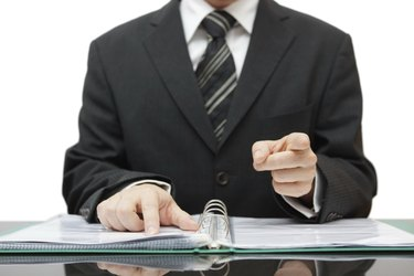 accountant or auditor pointing to you, gives a warning
