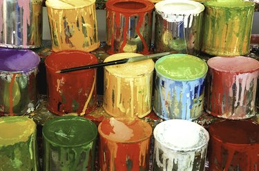 Close-up of large group of paint cans
