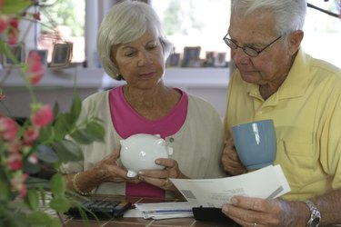 Close-up of a senior couple reading a bill