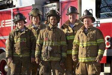 Firefighters standing near fire truck