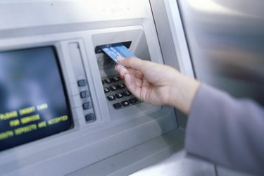 Person making an ATM transaction