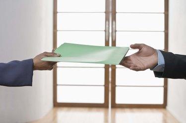Hands of people exchanging folder